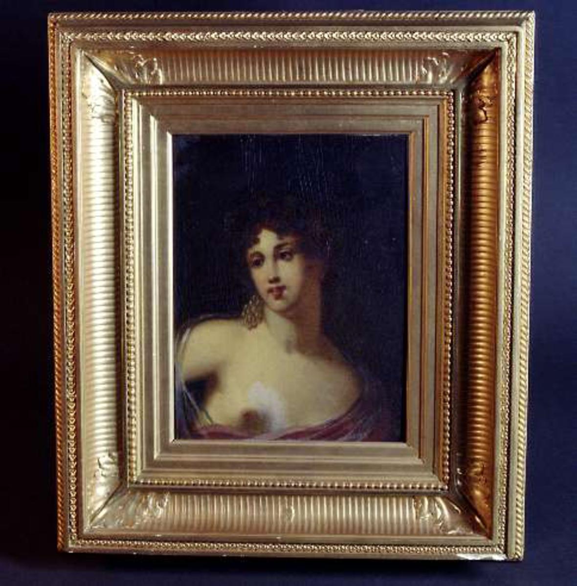 Porträtt av en kvinna.
