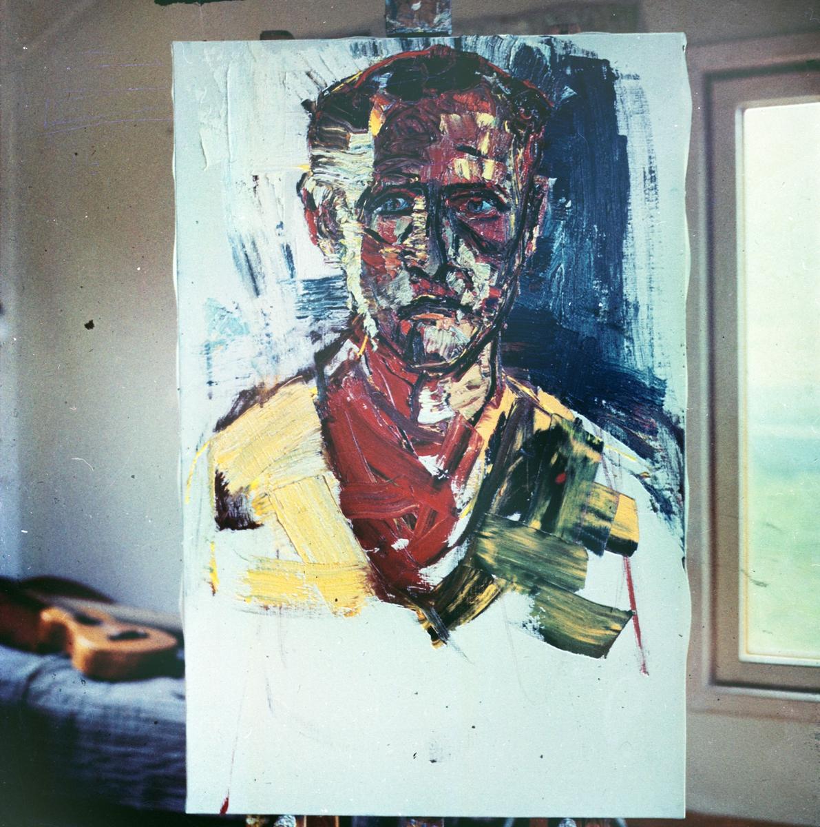 Oljemålning av konstnär Ragnar Johansson föreställande fotograf Gunnar Sundgren, i ateljén i Härjedalen