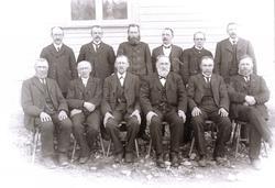 Portrett av 12 personer Konsmo Audnedal.