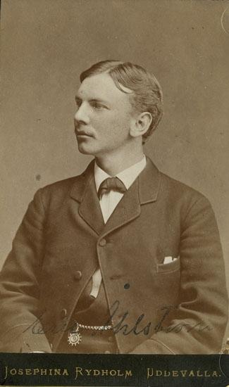"Text på kortets baksida: ""Erik Åhlström""."