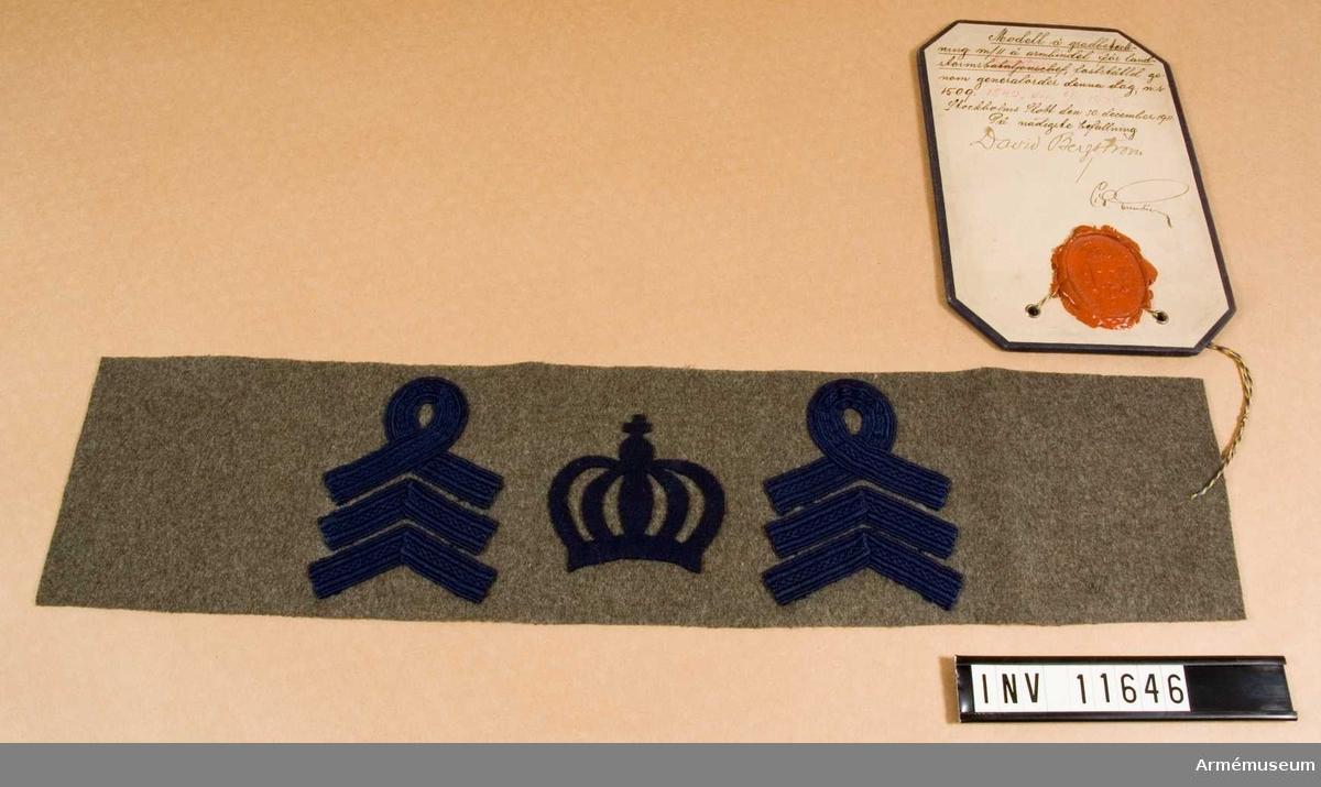 Grupp C I.  Modell å gradbeteckning m/1911 å armbindel för landstormkapten, fastställd genom go nr 1540 den 6 juli 1935.