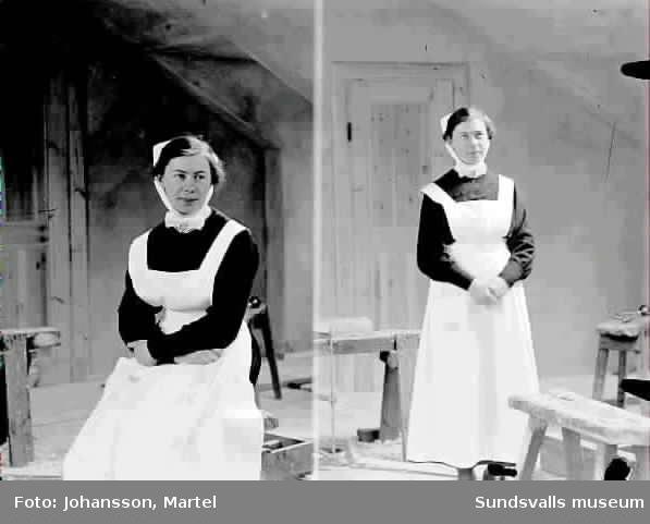 Kvinna i sjuksköterskeuniform.