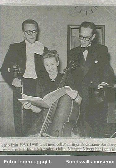 Restaurangtrio verksam under 1930-1950, I mitten cellisten  Inga Bökman-Sandberg, f 1911,  t.h. maken Evan på piano , t.v Hilding Melander  violin.                                                             Fotografiet tillhör musikläraren Inga Sandberg. Bergsgatan 19 B, Sundsvall