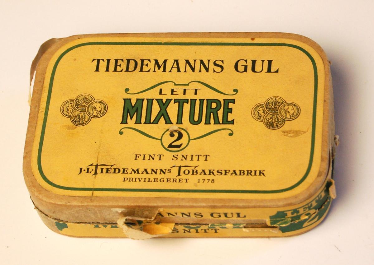 Rektangulær pappeske innvendig vokset til oppbevaring av tobakk.