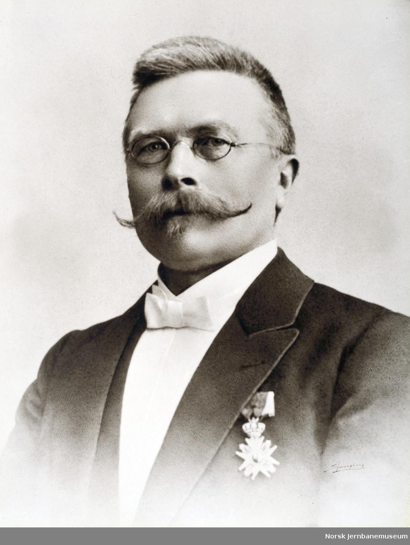 Portrett av driftsbestyrer Martinius Olsen