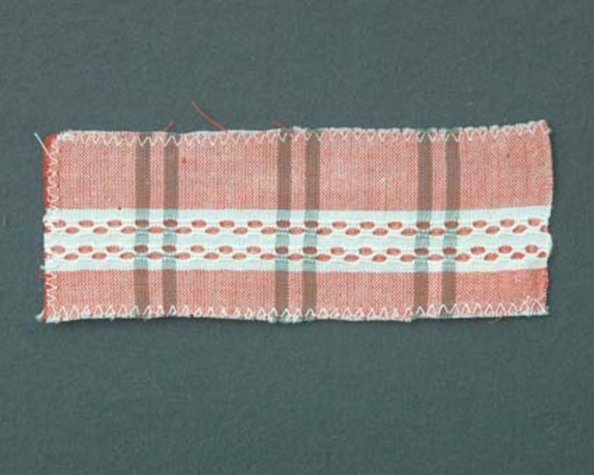 Bomullstyg till kjol och förkläde vävt i hålkrus och tuskaft.Vävsedel finns i pärmen Bomullstyger, Cottolintyger 170.