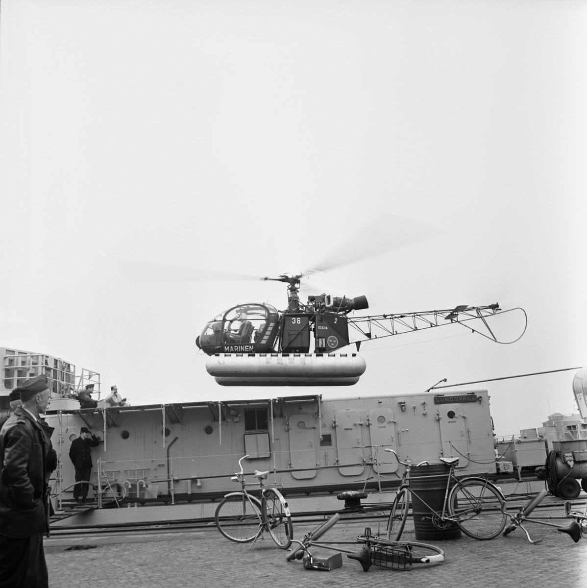 Övrigt: Fotodatum 9/11 1966 Byggnader och Kranar Freg. Sundsvall helikopterdäck. Närmast identisk bild: V37441 och V37442, ej skannade