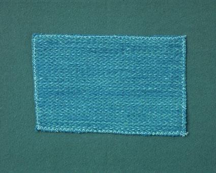 Blåmelerat möbeltygsprov vävt i korskypert med bomullsgarn i varp och och ull- och lingarn i inslag. Ytterligare prov och vävuppgifter finns i pärm Möbeltyg a, litt c 233.