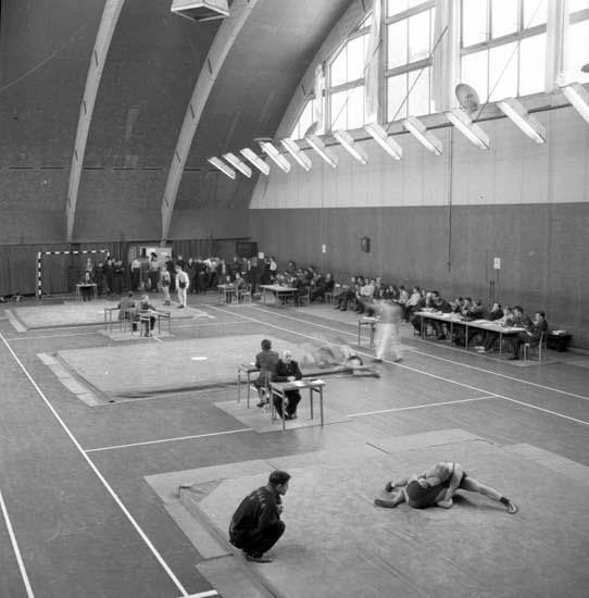 """Enligt notering: """"Brottning Trollhättan - UAK jan 1958""""."""