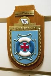 Medlemsplakett i redningsselskapet henger på Statfjord A.