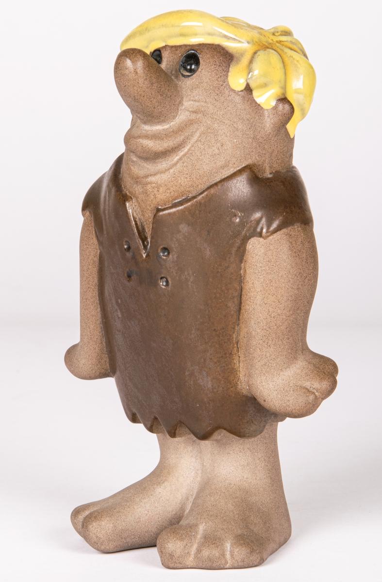 """Figurin i keramik föreställande Barney Granit ur serien """"The Flintstones"""" av Dorothy Clough för Gefle Porlinsfabrik/Upsala-Ekeby, 1957."""