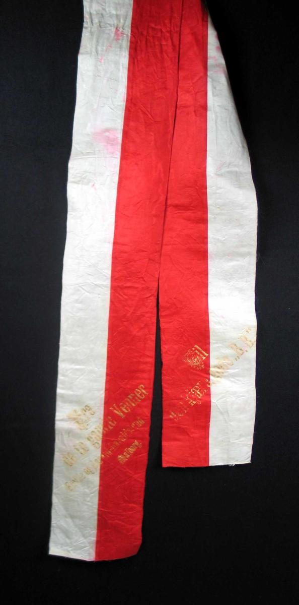 Begravelsessløyfe i svart, rød og hvit silke.