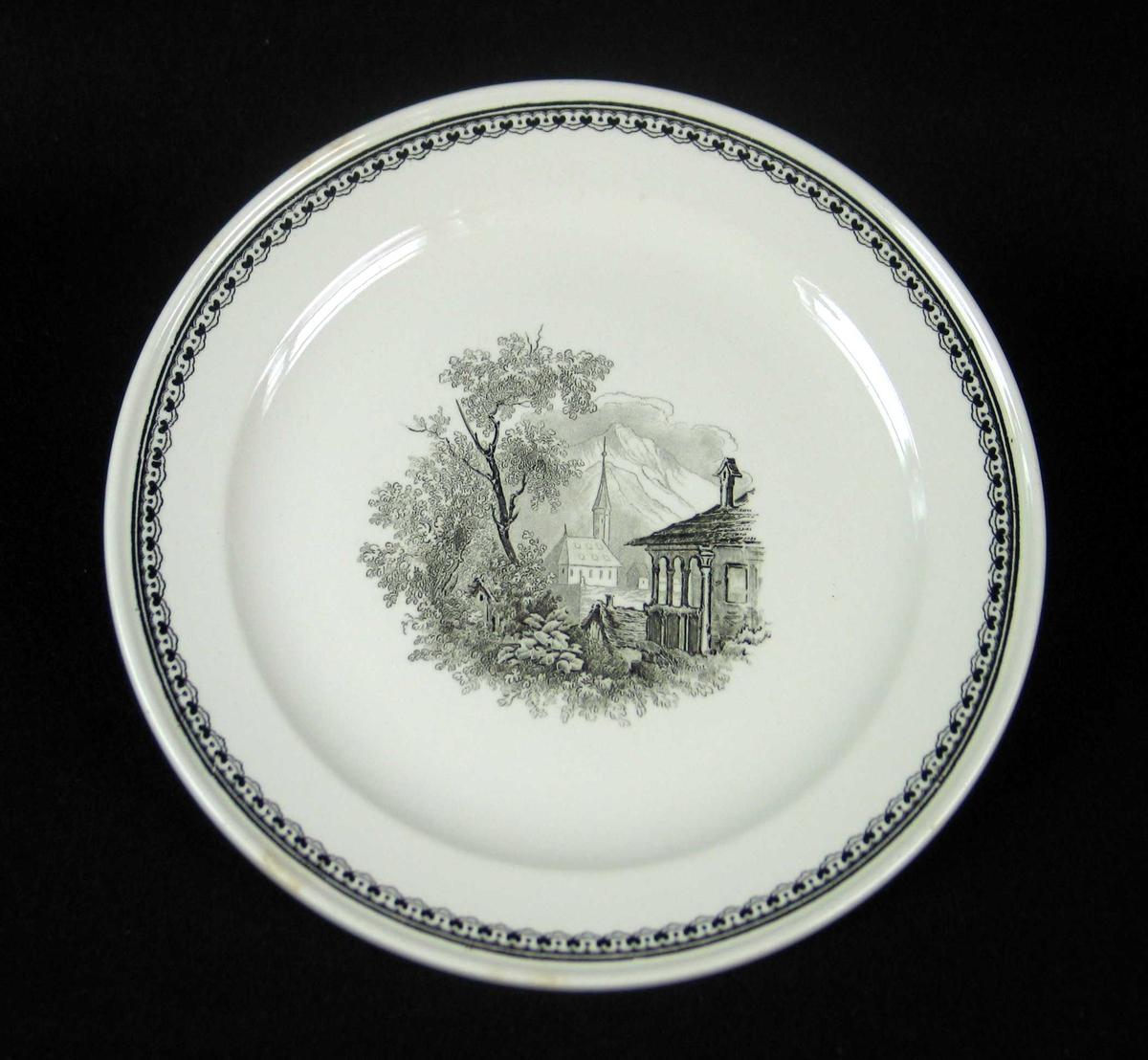 Asjett i offwhite keramikk med sort dekor. .
