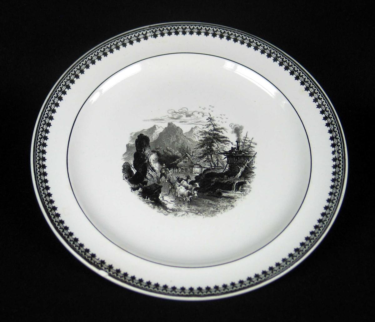 Rundt serveringsfat med bred kant i offwhite keramikk med sort dekor.