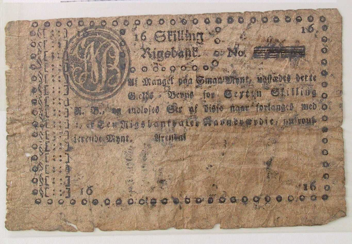 Gotisk trykk.  Øverst: 16 Skilling / Rigsbank. tilh. monogram. NB. tilh. nummer er uleselig.    Som nr. 486.  NB. tilh.nummer (uleselig)..