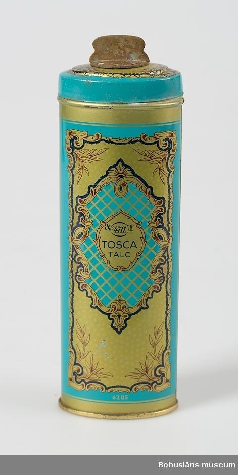 Ovalformad burk med lvridbart ock för ströfunktion. Innehåller talken 4711 Tosca. Turkos bakgrund med mönster i guld.