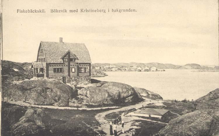 """Tryckt text på kortet: """"Fiskebäckskil. Bökevik med Kristineberg i bakgrunden."""" """"Förlag: Tekla Bengtssons Pappershandel, Fiskebäckskil."""""""