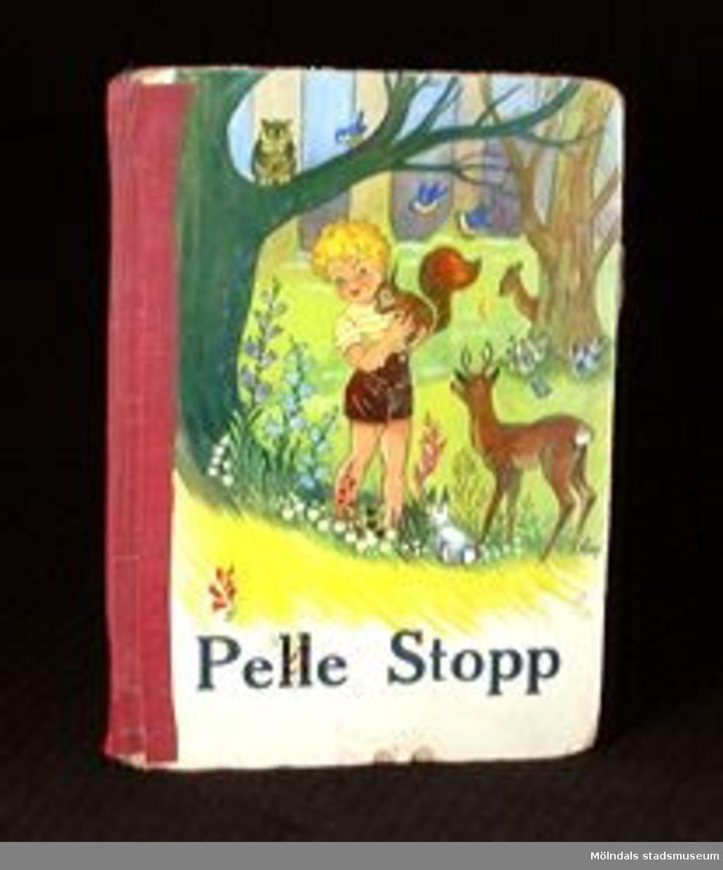 """Titel: """"Pelle Stopp"""". Text: Edna Christenssn Illustrationer: Aina Johansson.Utgiven av förlaget Kärnan AB i Helsingborg."""