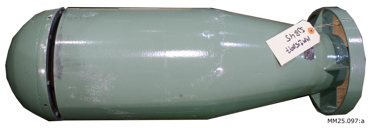 Gönmålad raketliknande sjunkbomb. I bakre änden sitter en ring med fenor i. Längs bak ett hål för att aptera undervattenständaren.