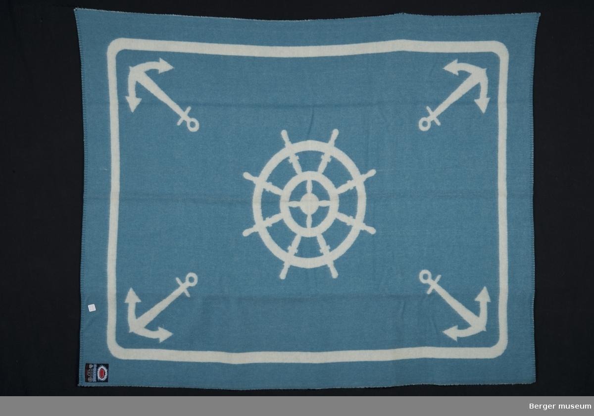 Båtpledd med anker i hvert hjørne og et ror i midten.