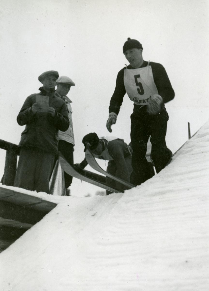Athlete Reidar Andersen at the top of ski jump at Garmisch