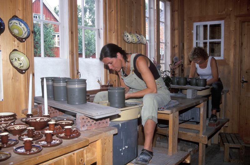 Two female potters at work