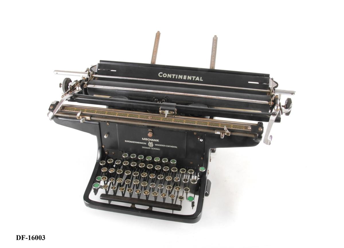 Manuell skrivemaskin med skrivevalse.