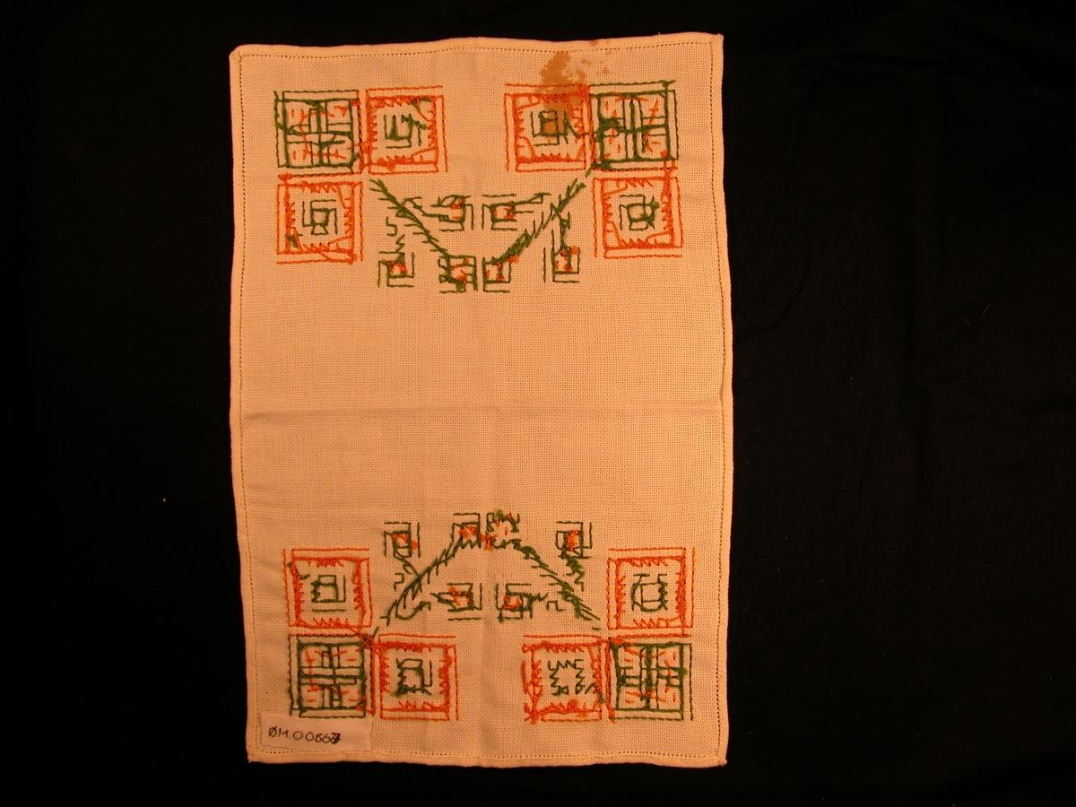 Tre kvadrat i kvart hjørne, to orange og ein grøn. To blomstrar på kvar halvdel av duken.