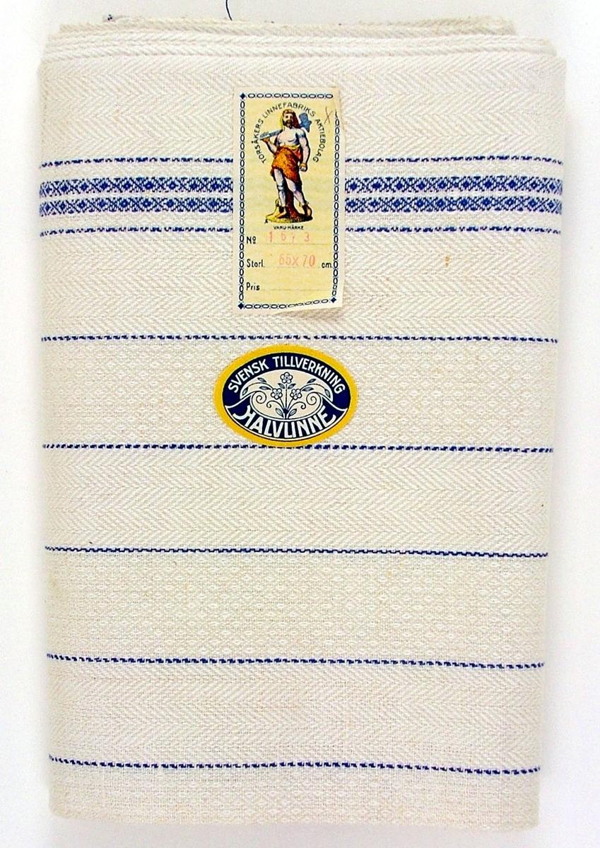 Oklippt, maskinvävd handduksväv av halvlinne tillverkad vid Torsåkers linnefabriks aktiebolag. Verksam omkring 1923-1957 (med viss reservation) Vävd i kypertvariatinern med naturfärgad botten med blå effektränder. Försedd med pappersetiketter med tillverkarens emblem