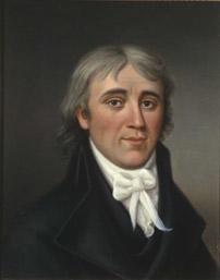 Portrett av Hans H. Nysom. Mørk drakt, hvit skjorte og halsbind.