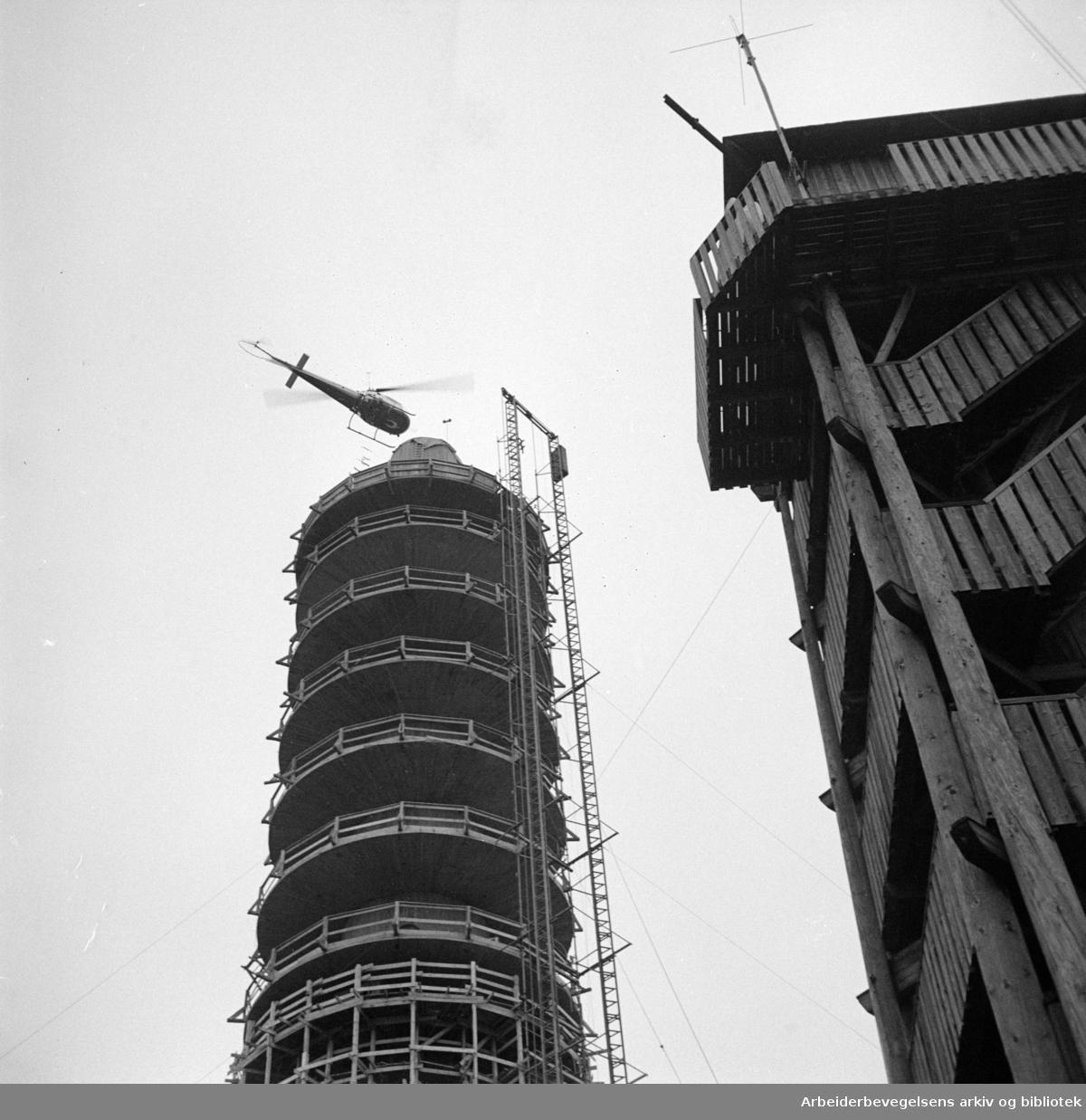 Nordmarka: Helikopter døper Tryvannstårnet. Oktober 1960