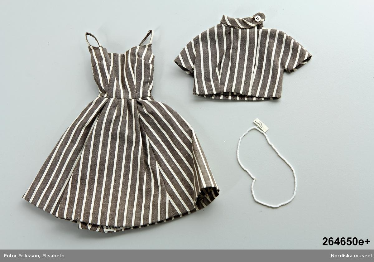 Katalogkort:  e 1-2) 1) klänning            2) jacka, bomull, vit- och brunrandig, halsband