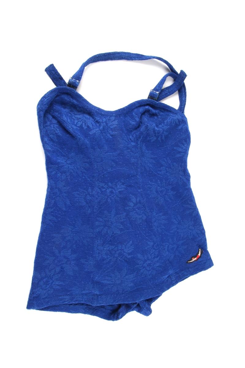 Blå badedrakt til dame med justerbare skulderstropper.