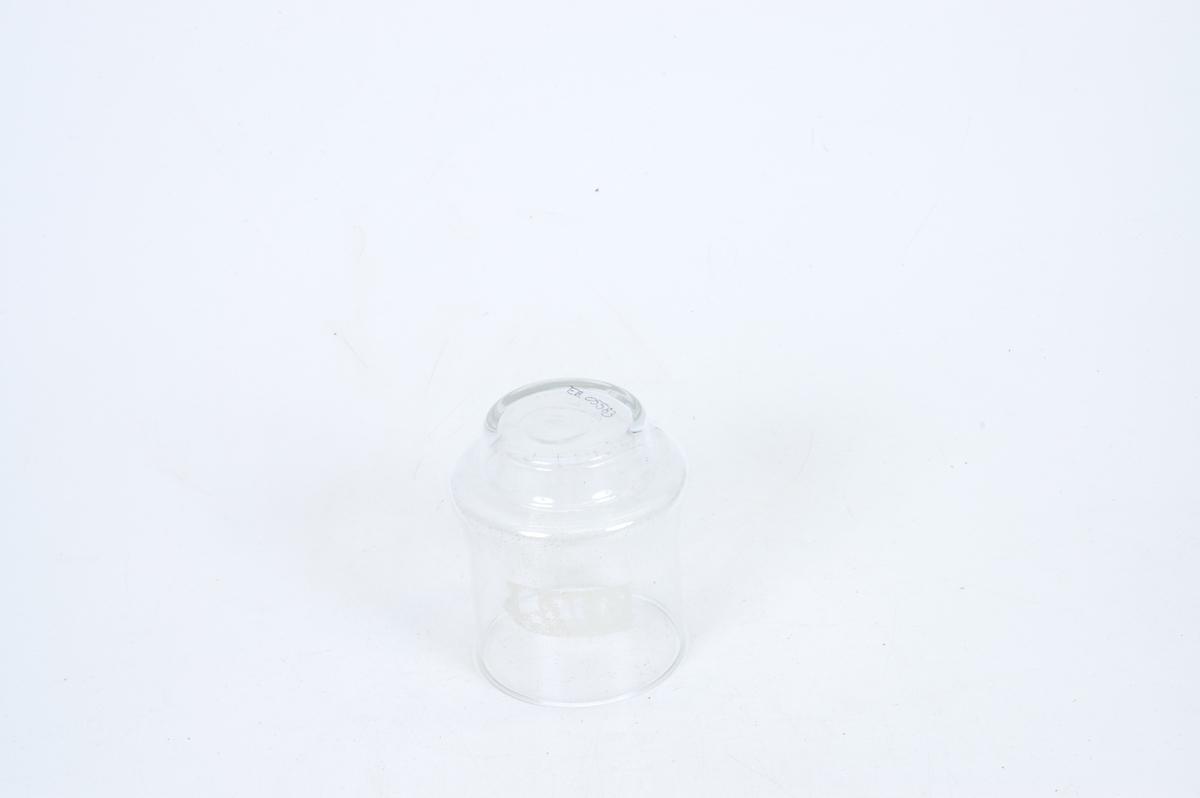 Form: sylinderformet med en bulk langt nede