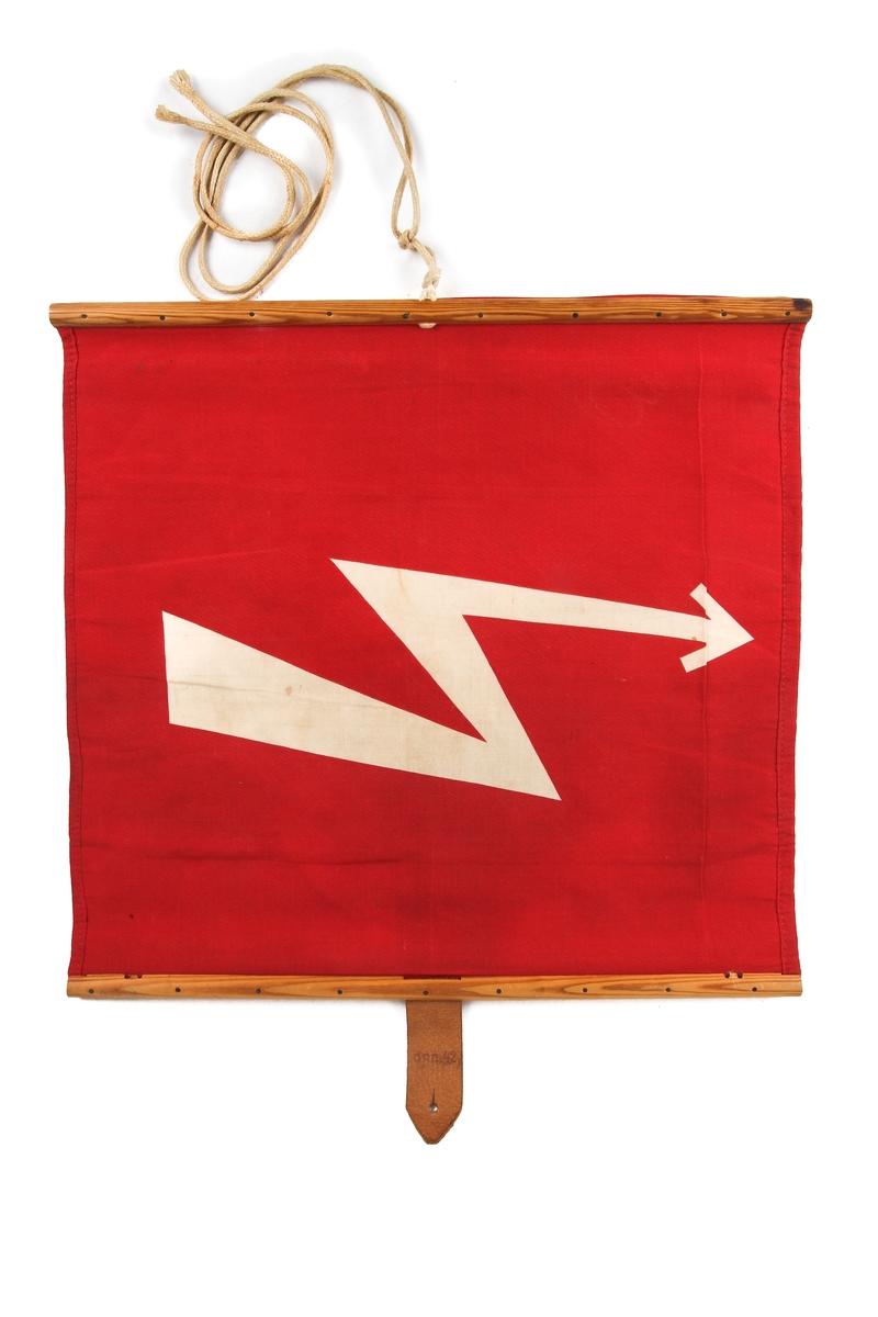 Rødt flagg med hvitt høyspentsymbol