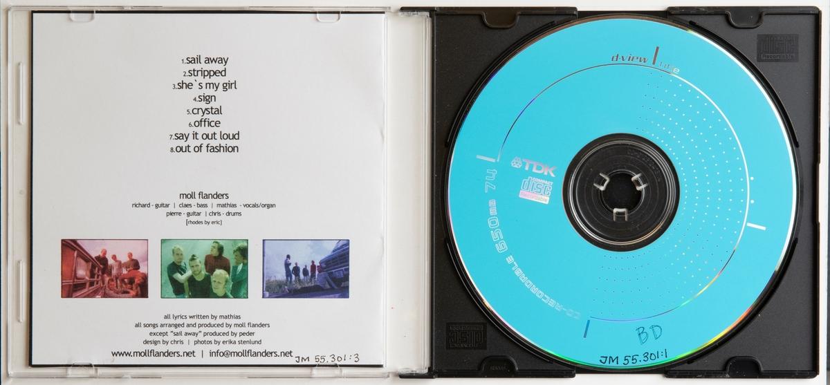 CD-skiva, demo, musik med gruppen Moll Flanders. Skiva i tvådelat, hårt palstfodral med inlaga i framsidan. Framsidan har ett färgfotografi.   Innehåll 1. Sail away 2. Stripped 3. She's my girl 4. Sign 5. Crystal 6. Office 7. Say it out loud 8. Out of fashion  JM 55301:1, Skiva JM 55301:2, Fodral JM 55301:3, Inlaga
