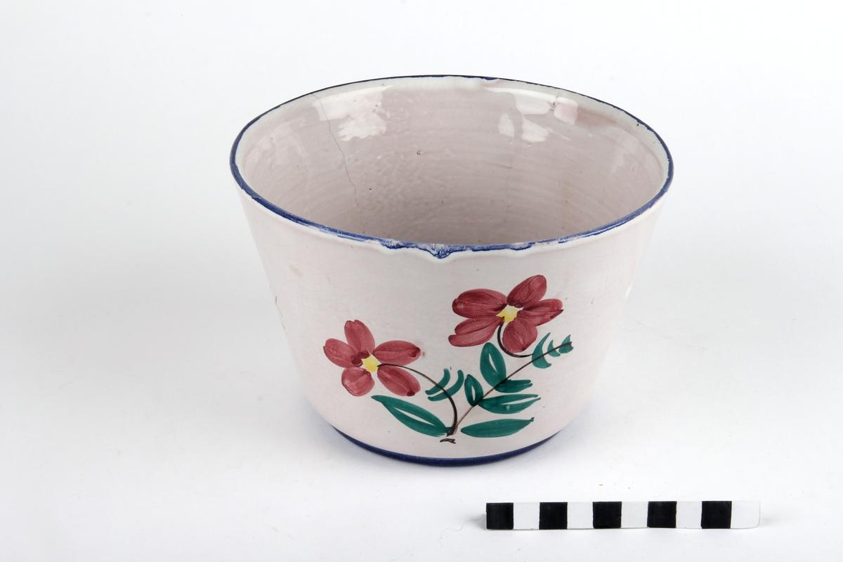 Potteskjuler med blomsterdekor