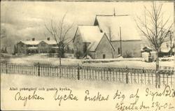 Vykort med motiv över prästgården och gamla kyrkan på Alnö.