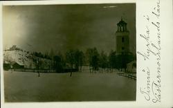 Vykort med vintermotiv över Kyrkan i Timrå.