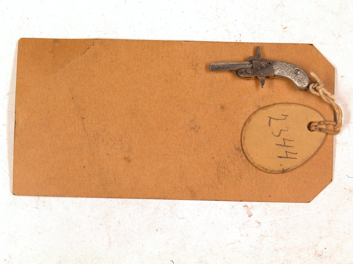 Berloque type pistol for 2mm stifttenningspatron.