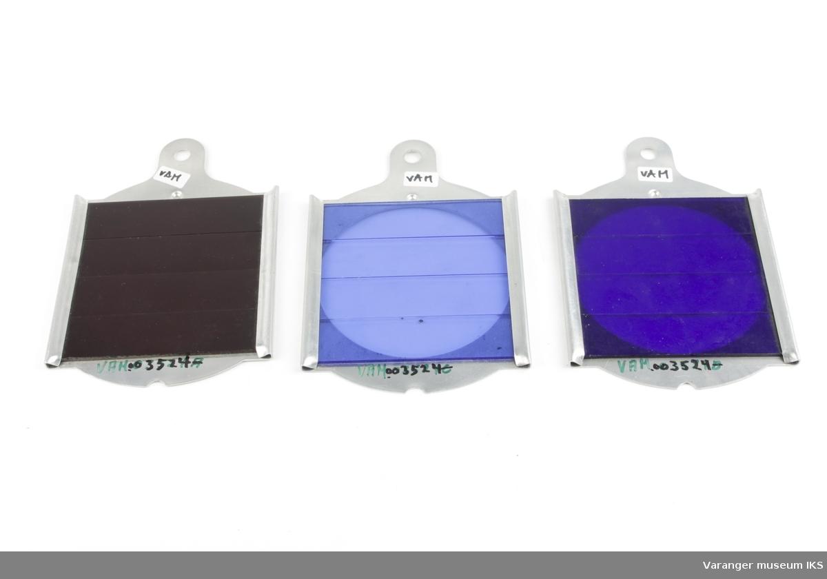 Signalglass i ulike farger. Metallramme med farget glass.