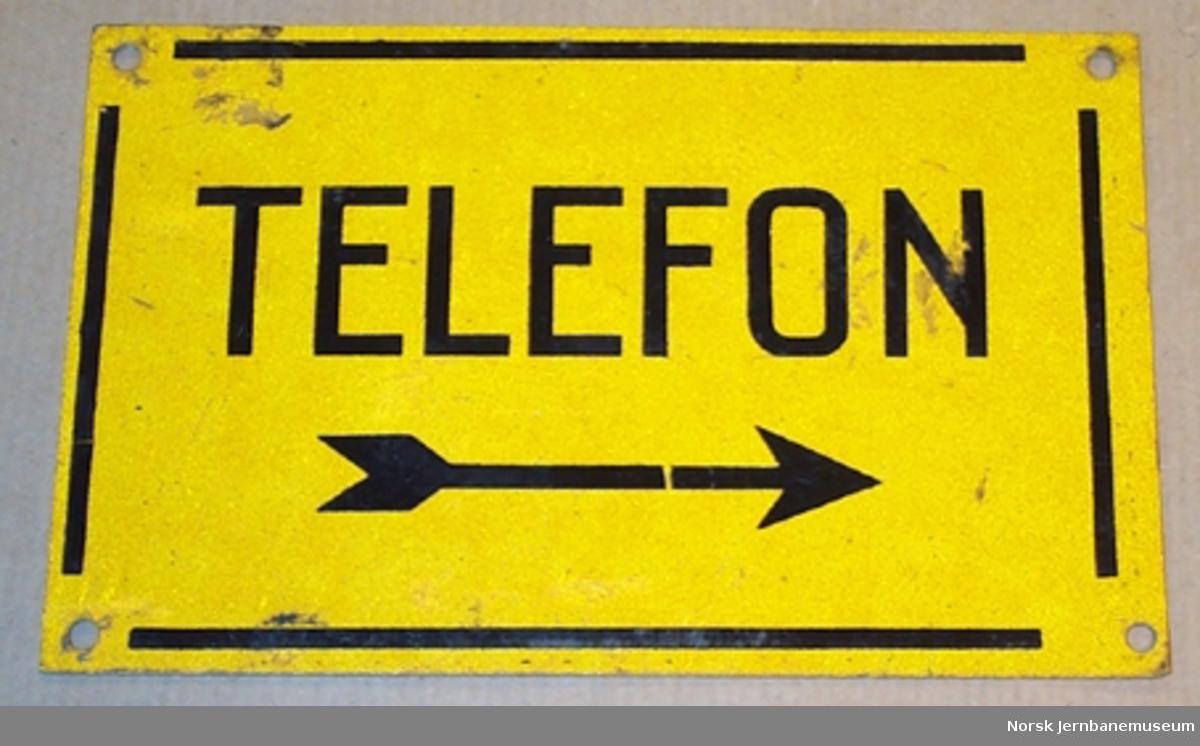 """Skilt fra linjen : """"Telefon"""" med pil"""