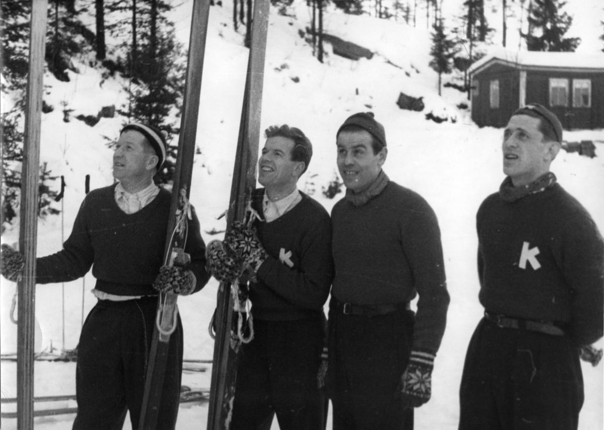 Kongsberg skiers Birger Ruud, Asbjørn Ruud, Vidar Lindbo Hansen and Petter Hugsted jumping for KIF.