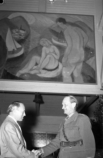 """Enligt notering: """"Tavla Avtäckes på Reg I 17 22/6 1948""""."""