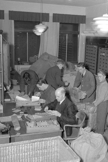 """Enligt notering: """"Julbrådska på Posten Dec 1949""""."""