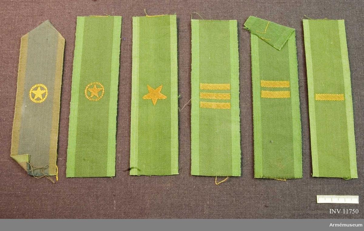 Grupp C I.  Gradbeteckningar till vapenrock m/1958 och m/1959, vicekorpral, korpral, furirt, sergeant och fänrik.