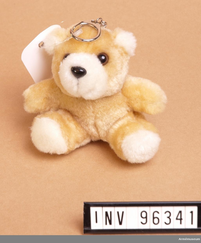 Nyckelring i form av nallebjörn.