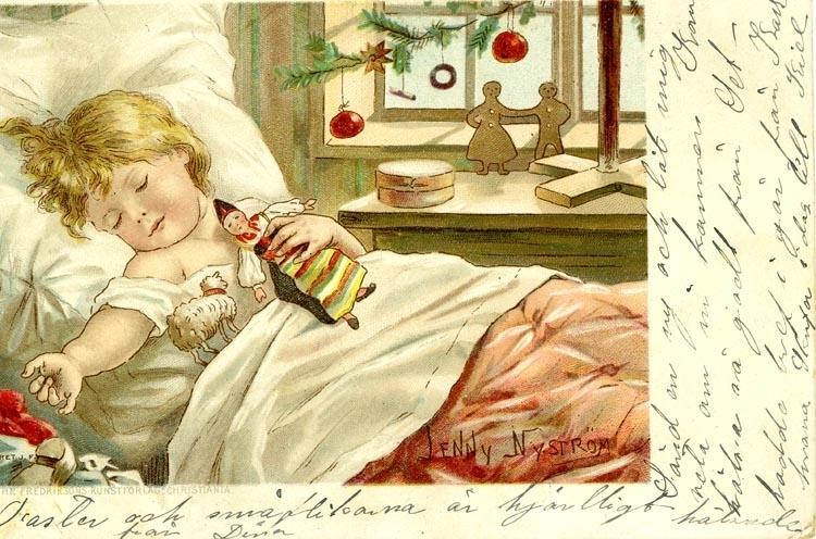 Julkort. Ett  sovande barn i sin säng med några av sina julklappar