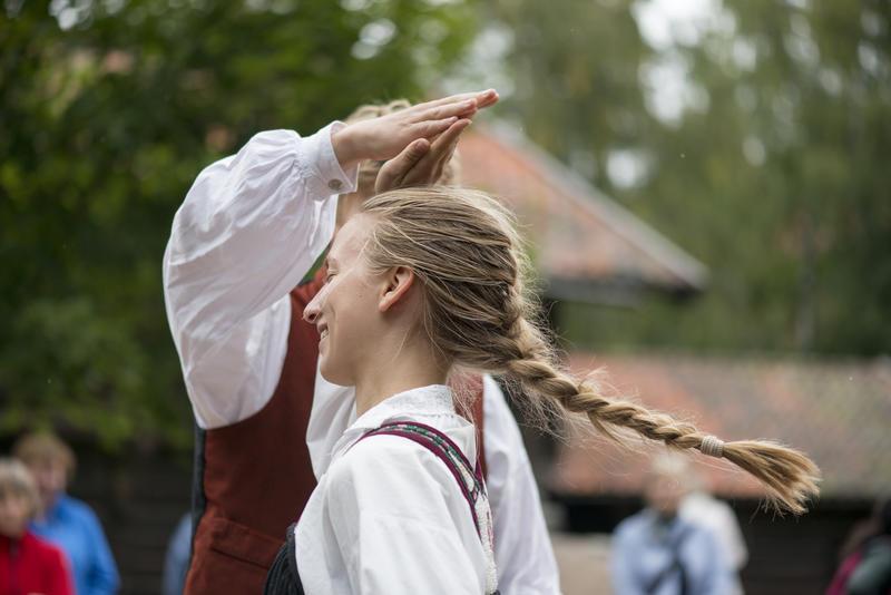 Woman and man dancing folk dance in National costume