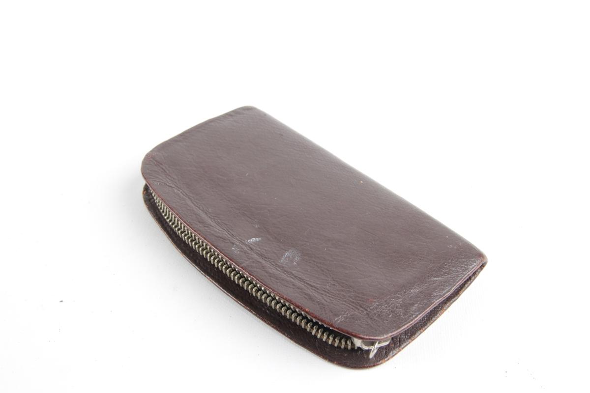Lommebok med glidelås.